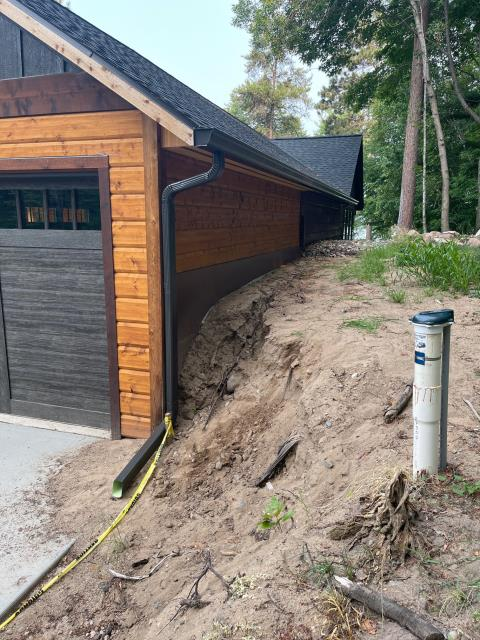 """Crosslake, MN - Installed new 6"""" k-style seamless gutters with 3x4 downspouts on the back side of garage located in Crosslake, MN."""