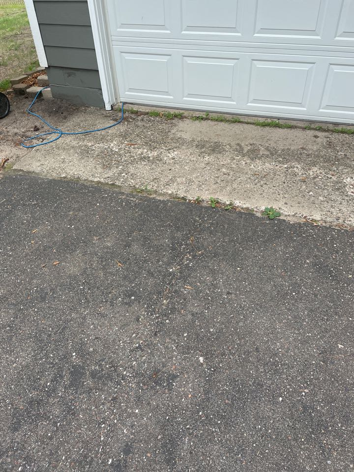 Baxter, MN - Damage to concrete from not having gutters on this home for years contact Advantage Seamless gutters to protect your home your concrete driveways asphalt driveways and pavers Best Gutters in Lake country Advantage Lakes leader in gutter protection