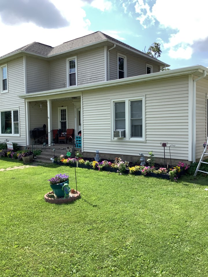 """Grinnell, IA - Install 6 inch seamless gutters on rubber roof with 3 x 4"""" downspouts."""