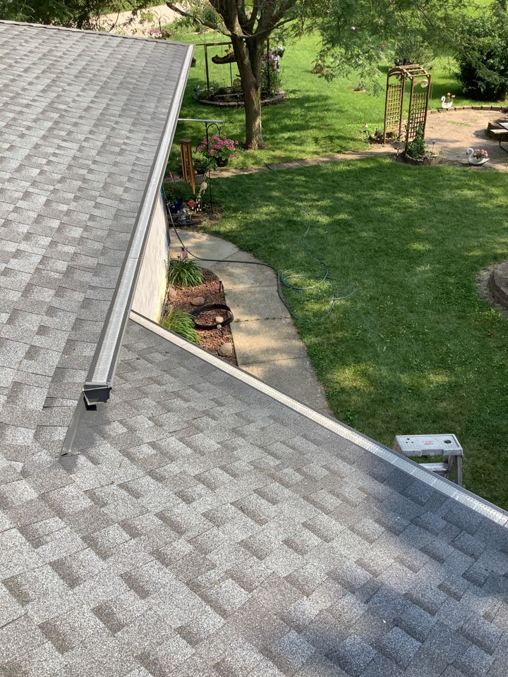 """Perry, IA - Install 5 inch seamless gutters color match to facia, with 3 x 4"""" downspouts with tile adapter. Install Seamless Gutters with hand miters. Installed fantastic, excellent gutter covers that blocks debris as small as Pine needles"""