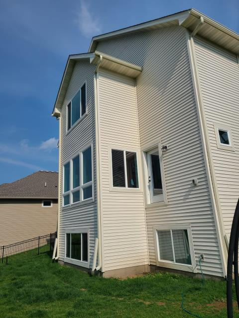 """Lakeville, MN - Added new 5"""" seamless gutters on house and garage located in Lakeville, MN."""