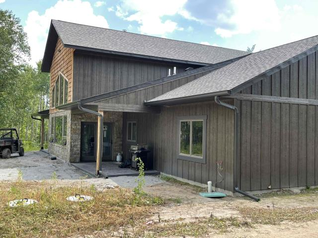 Onamia, MN - Installed new 6 inch k style gutters with 3x4 inch downspouts with Valor gutter guard protection on this beautiful home located in Onamia, MN.