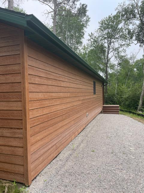Pine River, MN - Added new 5 inch gutter with 3 x 4 downspouts to both sides of this cabin located in Pine River, MN.