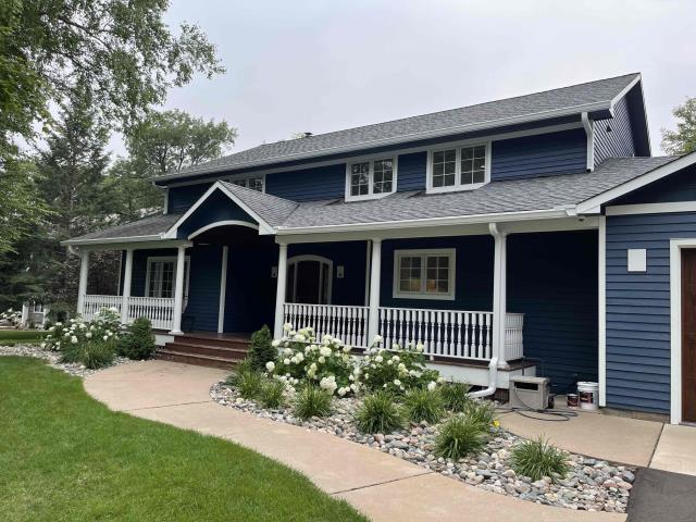 """Baxter, MN - Added new 6"""" seamless gutters and 3x4 downspouts with our Valor gutter protection to this home located in Baxter, MN."""