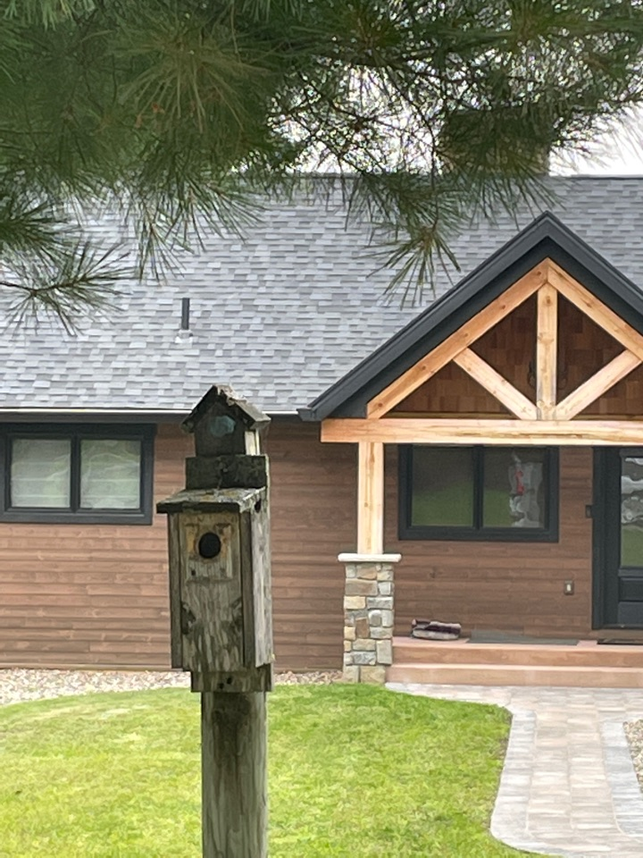Crosslake, MN - Adding dollar gutter protection to keep the gutters clean and protect it for years to come with this beautiful home call Advantage Seamless gutters 5 inch 6 inch half round designer gutters best gutters in Lake country best let gutters and Crosslake