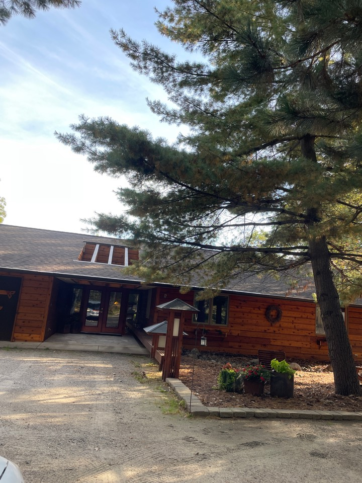 Pequot Lakes, MN - Replacing old gutter protection with Valor gutter protection to protect this home for years to come protection from Pine needles and leaves and debris no more clogged gutters 5 inch 6 inch half round designer Gutters Best Gutters in Crosslake in Lakes area. Call Advantage Seamless Gutters.