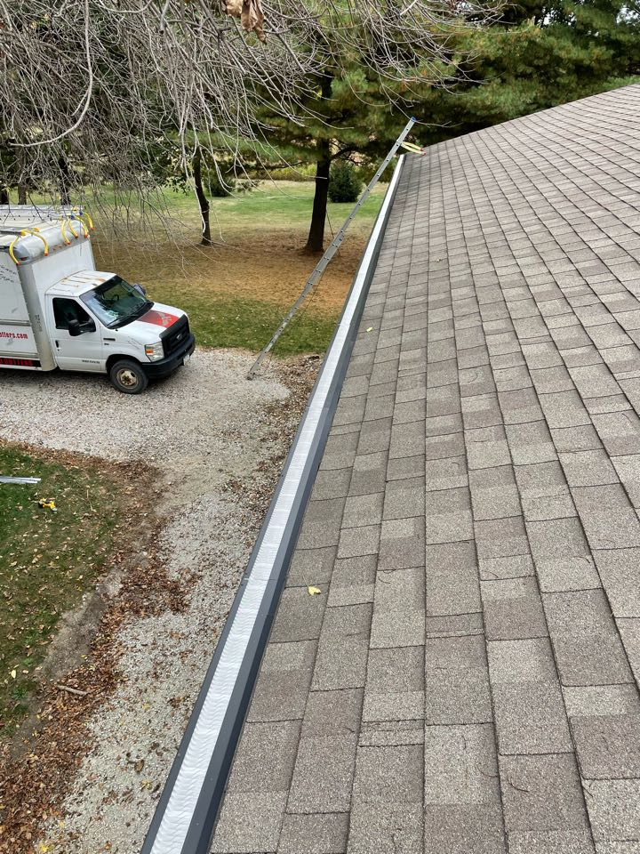 """Adel, IA - Install 6"""" seamless gutters with 3by4 inch downspouts. Install valor gutter guard protection and downspouts hinges"""