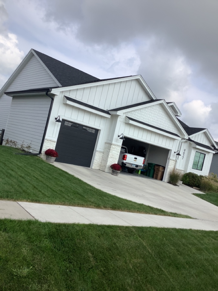 """Johnston, IA - Install 6 inch seamless gutters with 3 x 4"""" downspouts. Install color match downspouts, install tile adapter, install hinges two downspouts."""