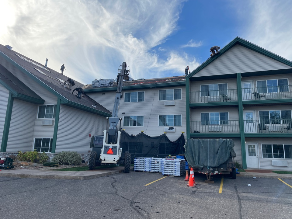Baxter, MN - At the Baymont Hotel in Baxter Minnesota with Neumann roofing.  Neumann knows roofing and Advantage Seamless Gutters knows Gutters.  Best gutter installer. Seamless gutters near me. Best gutter cover. Best gutter guard