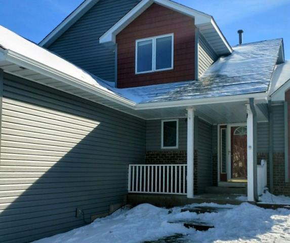Lino Lakes, MN - Even in the winter we are installing custom seamless gutters.