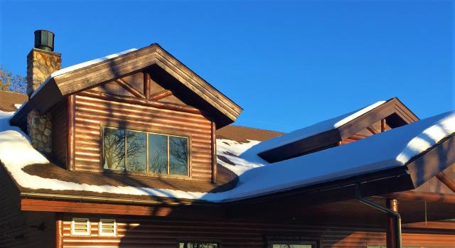 """Nisswa, MN - Some Half Round 6"""" seamless gutters on the Grand View Lodge pool house and some 5"""" and 6"""" K-styles on the cabins at Grand View Lodge. Get ready for the summer!"""