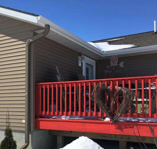 Dent, MN - Protect your deck from water damage with Advantage Seamless Gutter's K-style gutters. No project is too big or small.