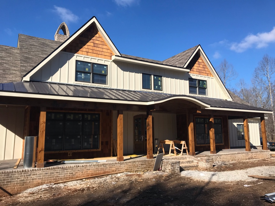 Knoxville, TN - Performing a roof inspection at Emily's new construction home