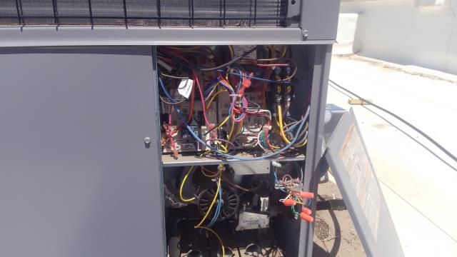 Albuquerque, NM - Checking electrical components of the rooftop HVAC unit