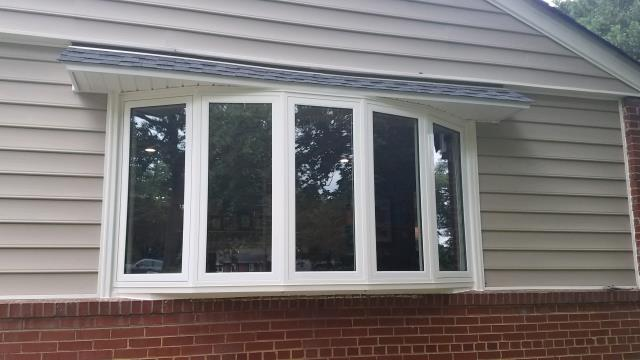 Richmond, VA - Replaced 5 lite bow window with a quality vinyl product for this customer that consists of casement style windows!