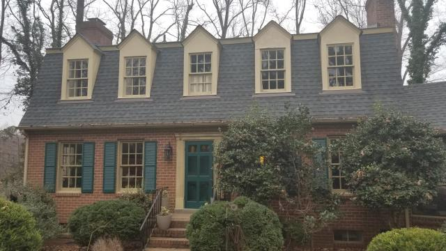 Richmond, VA - Vinyl replacement windows going in this 1962 home. This customer chose to go with a wood-tone interior option on some of their windows as well!