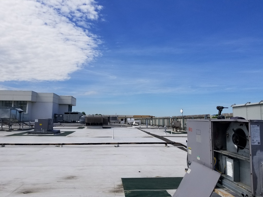 Bensalem, PA - Commercial Air conditioner service call in Bensalem. check Carrier roof top unit - air conditioner is not cooling. found a problem with blower belt. install new belt, adjust belt tension. check freon pressures. check air conditioner operation.