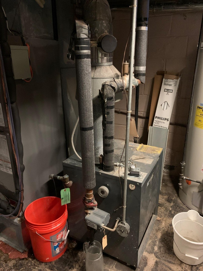 Philadelphia, PA - emergency boiler leak repair in Philadelphia. repair leak on Weil McLain gas boiler. water is leaking from water shut off valve. water is leaking from pressure relief vavle. install new water ball valve. install new pressure relief valve. drain expansion tank. refill boiler with water. bleed air from radiators. check boiler heating operation.