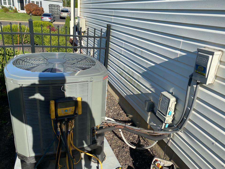 Perform Trane heat pump tune-up .