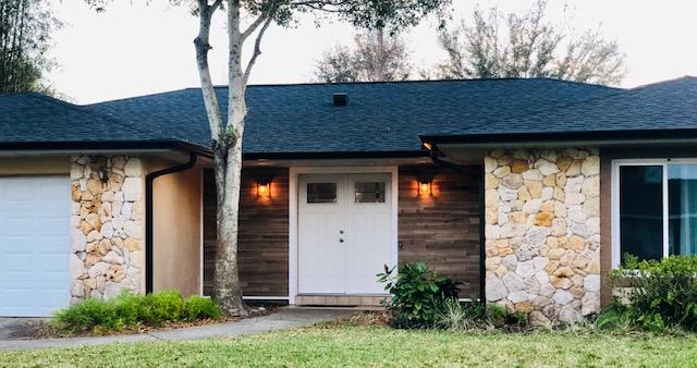 Belle Isle, FL - New Roof, Gutters, Front Door, Garage Door, and T&G in the Entry Way