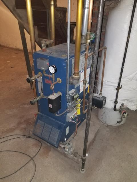 Utica Gas Steam Boiler repairs. Added water boiler treatment, installed new steam gauge, pressure control, pressure relief valve, and steam vents in mains and radiators. Also replaced drain valve at bottom of boiler.