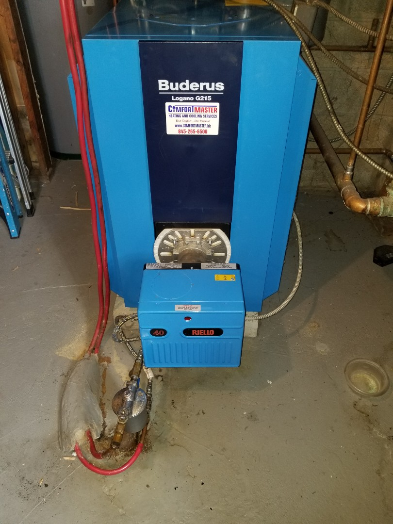Buderus Boiler smoking. Found smoke coming from shorted wires in aquastat control. Replaced control, repaired wiring and checked operation.