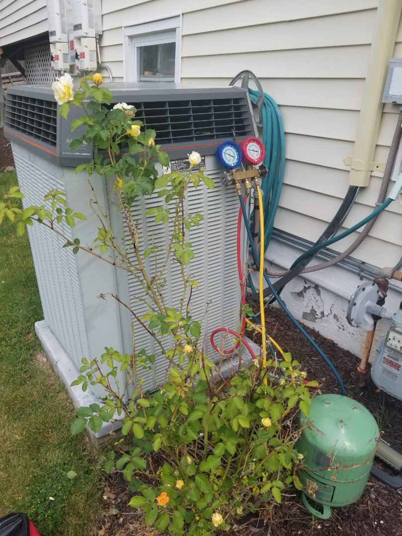 Fishkill, NY - Trane Air XL1200 Conditioning Unit blowing warm air. Found low on freon, and added refrigerant to proper level. Unit is leaking, but due to age, it may be time to consider a new system