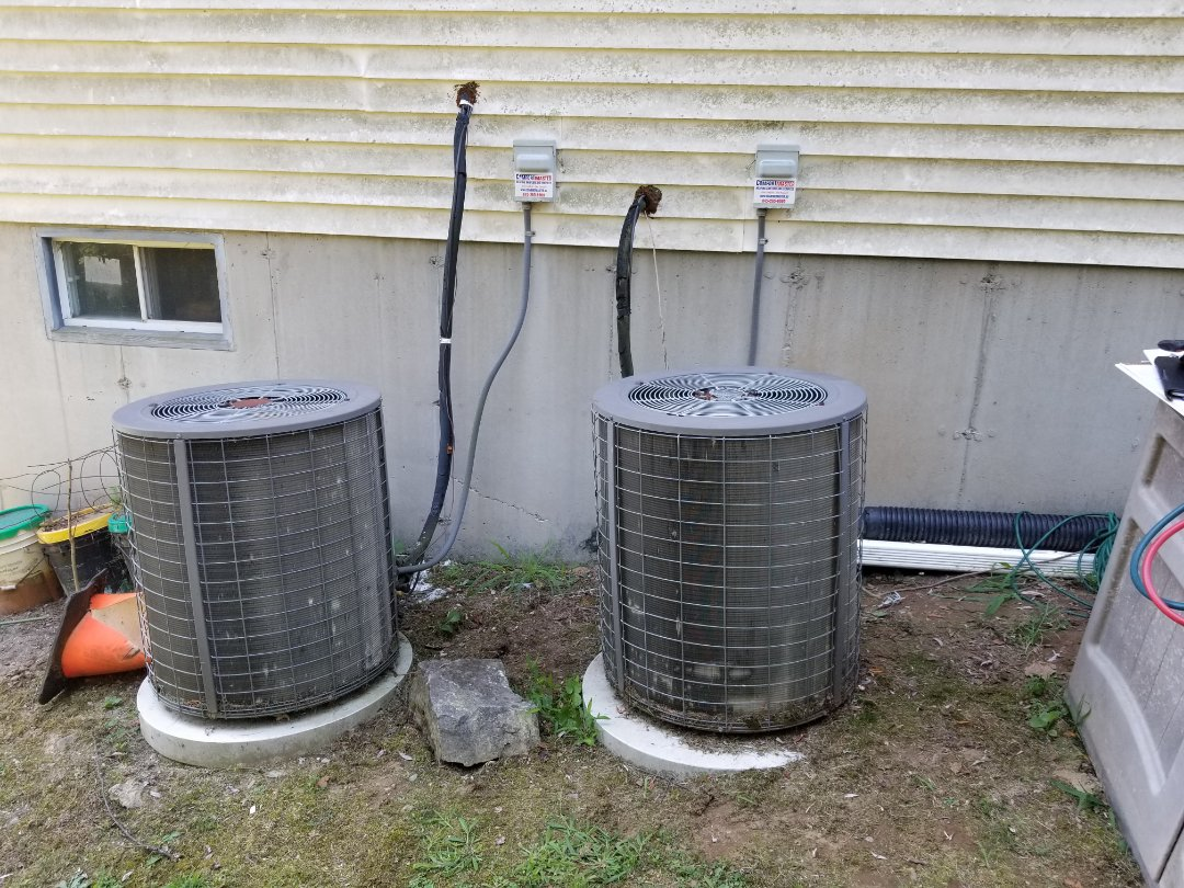 Hopewell Junction, NY - Tempstar AC systems not cooling. Found both outdoor units not running, but indoor units working. Tested and found bad capacitors. Replaced and tested operation and freon levels. Systems are old and in need of deep cleanings.
