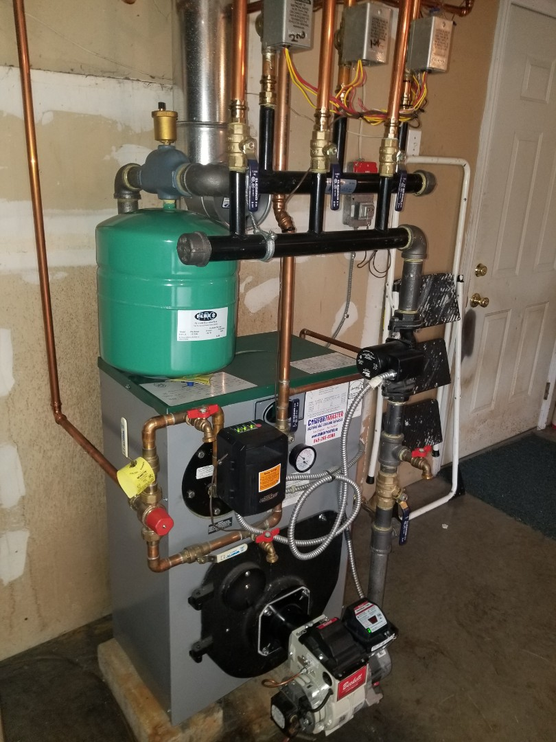 Hopewell Junction, NY - Peerless oil boiler, with tankless water heater and 3 heating zones Performed annual cleaning and burner tuneup