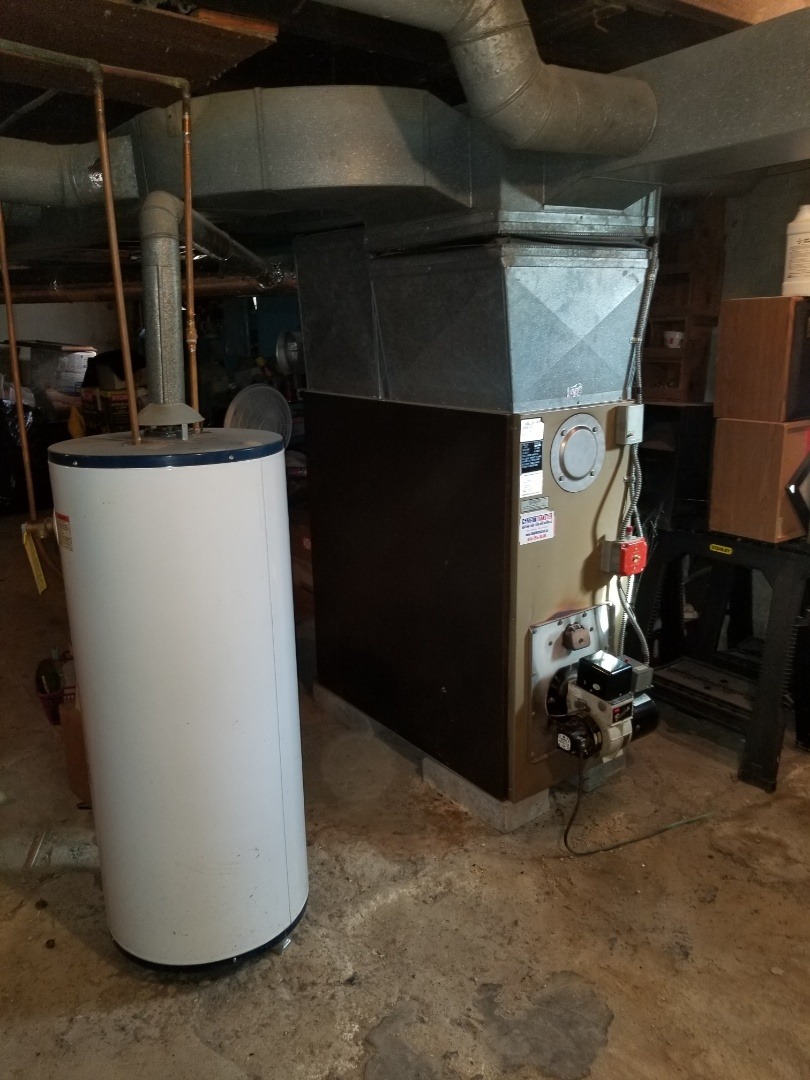 Hallmark Oil Furnace Tune up. Flue pipe in poor condition and needs to be replaced. Whirlpool Water Heater improperly vented into furnace flue.