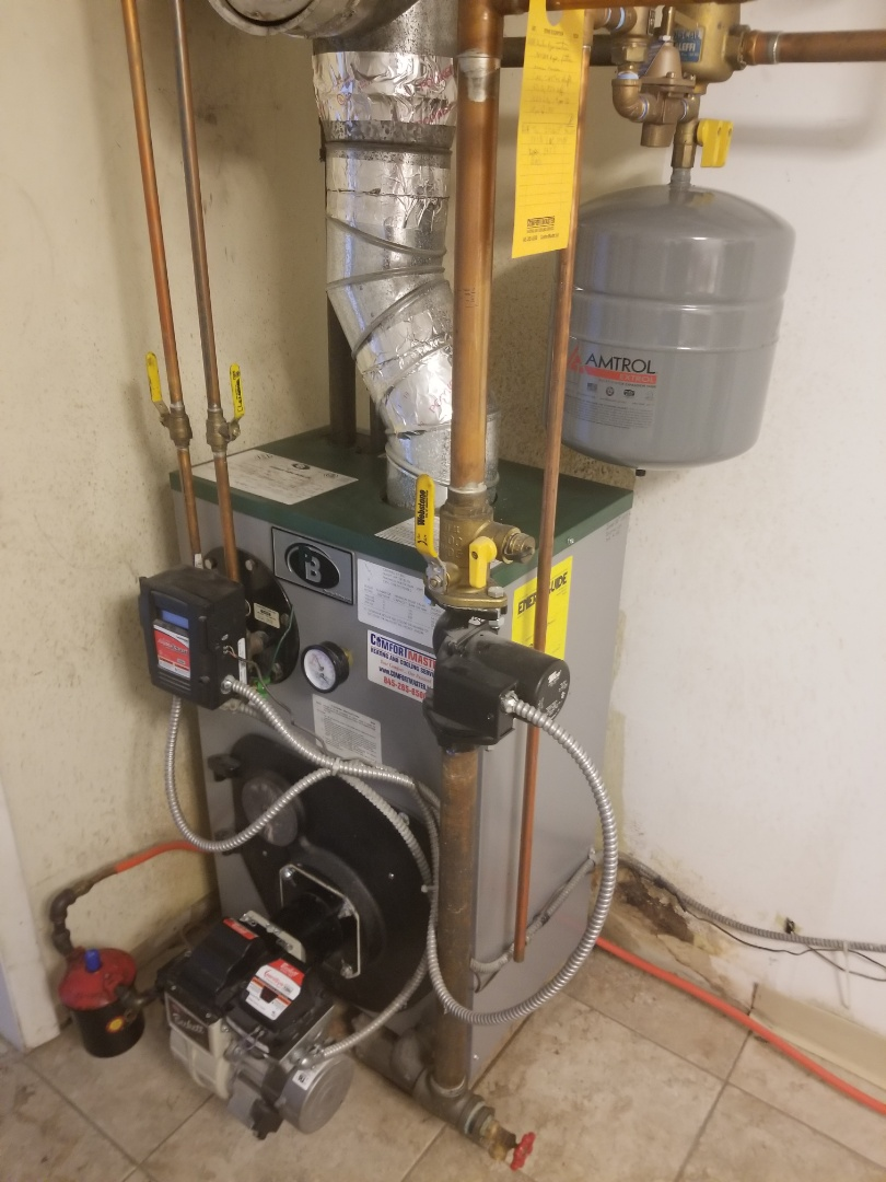 Stormville, NY - Peerless oil boiler not producing enough hot water. Performed annual maintenance tune up, and recommended chemical cleaning of tankless water heater coil.