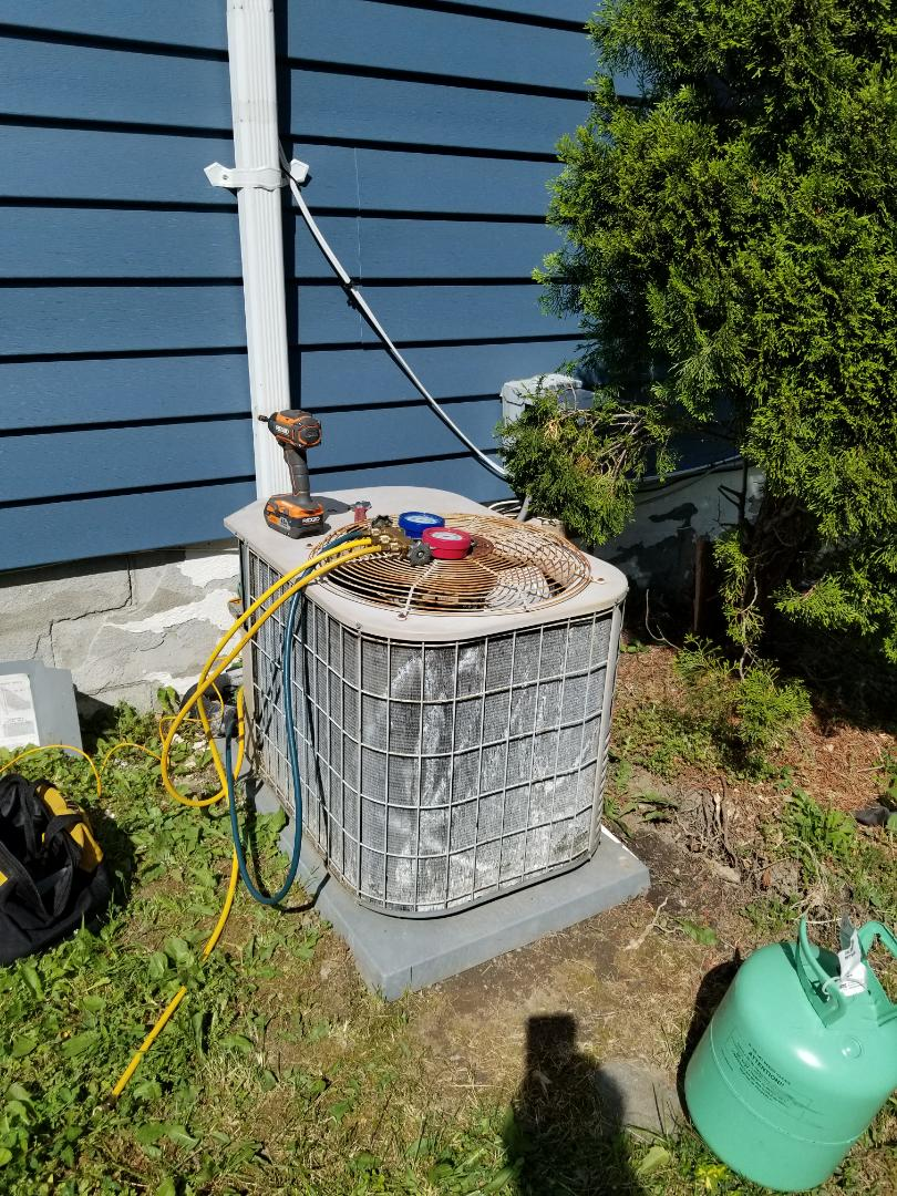 Wappingers Falls, NY - York air conditioning unit frozen and not cooling. Found system low on freon and recharged. System has a leak and based on age and condition, it would make more sense to replace equipment rather than repair it.