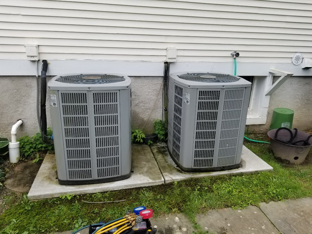 Brewster, NY - Trane / American Standard Air conditioning system tune up and inspection. Found compressor failing on downstairs system. Due to age and cost of repairs,  system should be replaced.