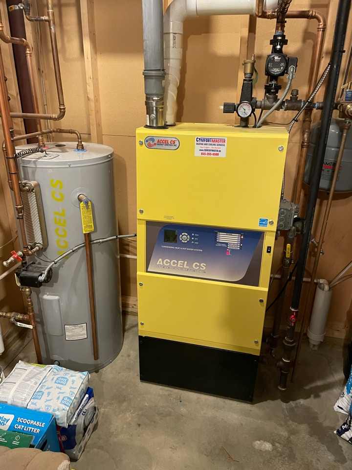 Energy Kinetics Accell CS maintenance tune up. Also performed annual maintenance of First Company Air Handler with Heil AC system