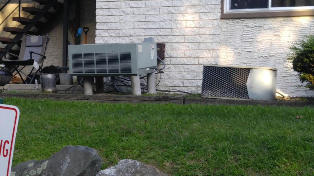 Unlevel air conditioner outside.