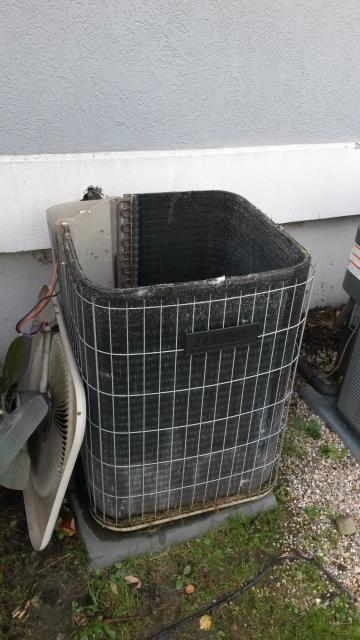 Hopewell Junction, NY - Lennox central air conditioning system, with bad compressor. Electrical short caused motor to burn-out and refrigerant to leak out.