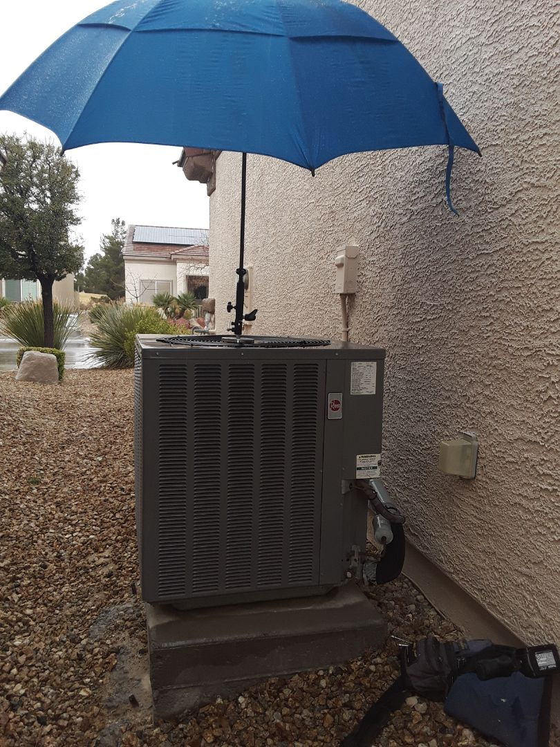 North Las Vegas, NV - Rheem AC system tune-up and maintenance check in sun city aliante Las Vegas!!! Raining.... HAH!!! Right Now Air is Unstoppable!!!