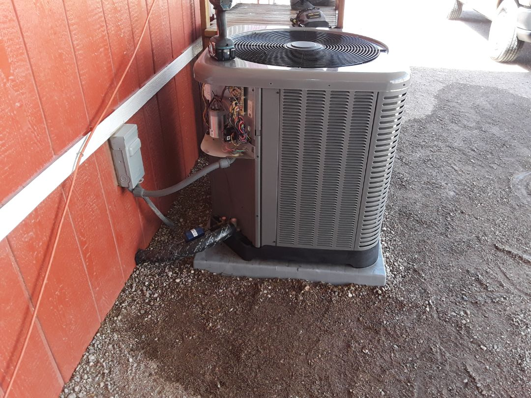 Henderson, NV - Rheem heat pump system cooling and heating tune up in Henderson