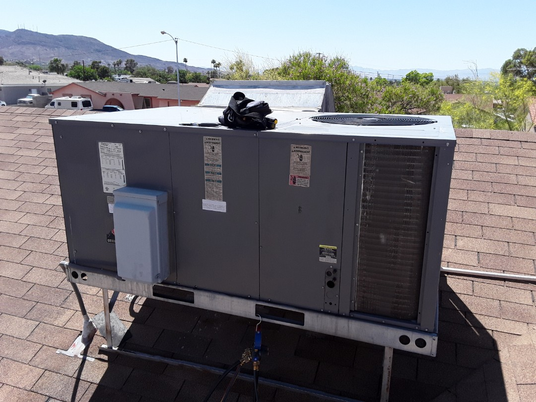 Henderson, NV - Rheem heat pump package system ac tune up Maintenance and Service in Henderson