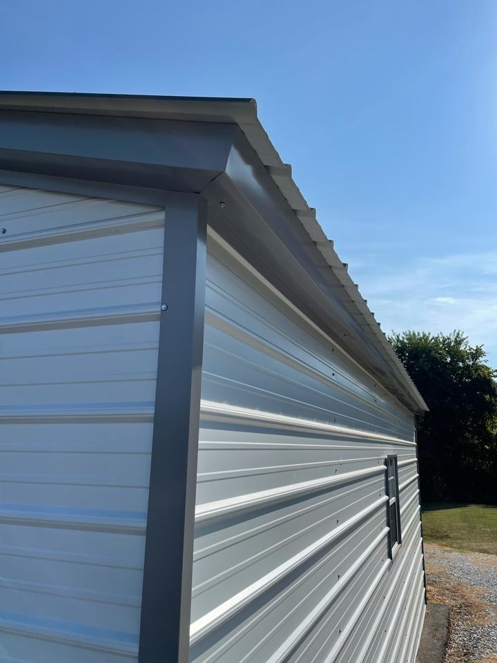 Lynchburg, VA - Discussing putting gutters on a prefab metal building