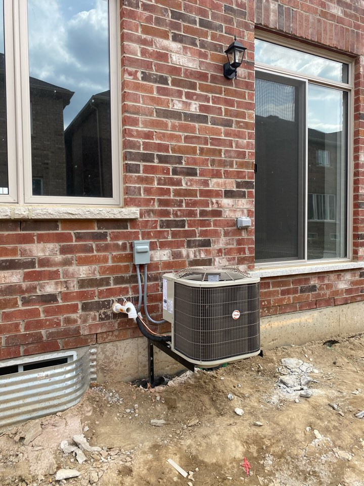 Brampton, ON - Install new 2 ton Payne air conditioning on brackets in Brampton in new subdivision.