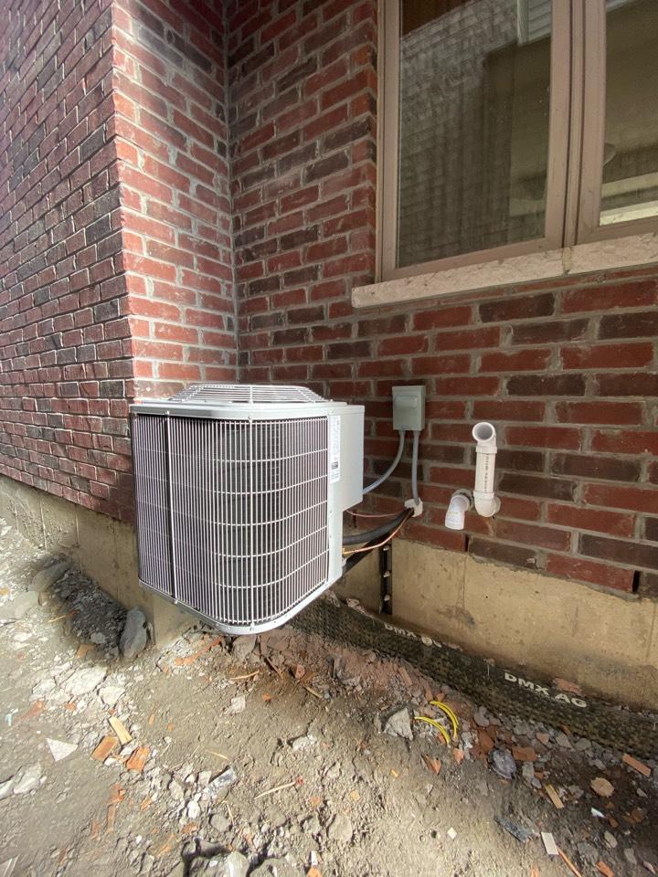 Bradford West Gwillimbury, ON - Install new Carrier 2.5 air conditioner on brackets in Bradford.