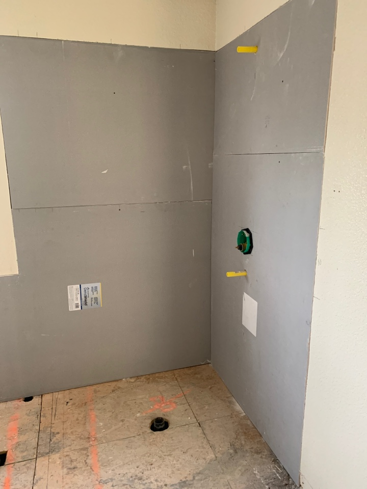 Brentwood, CA - Today we are completing the tile wet wall or backer board and rough plumbing at the floor also rough in a cast-iron freestanding bathtub