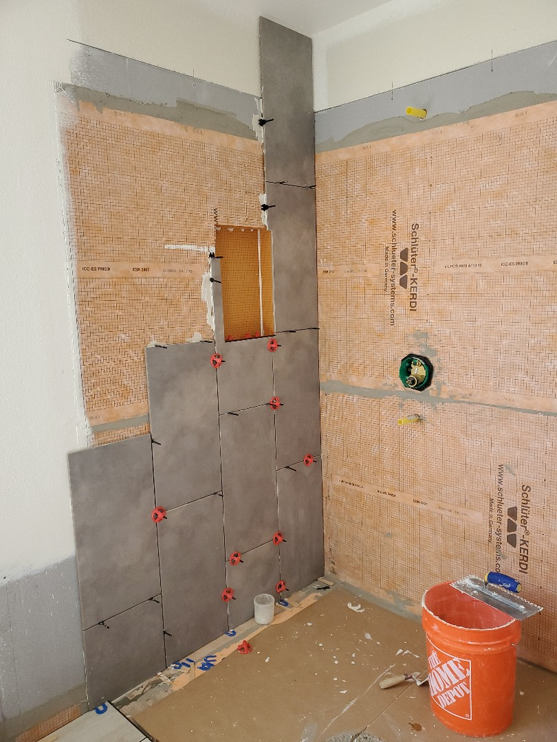 Brentwood, CA - Finish the floor yesterday tile lies starting the shower walls today The grouting still needs to be done