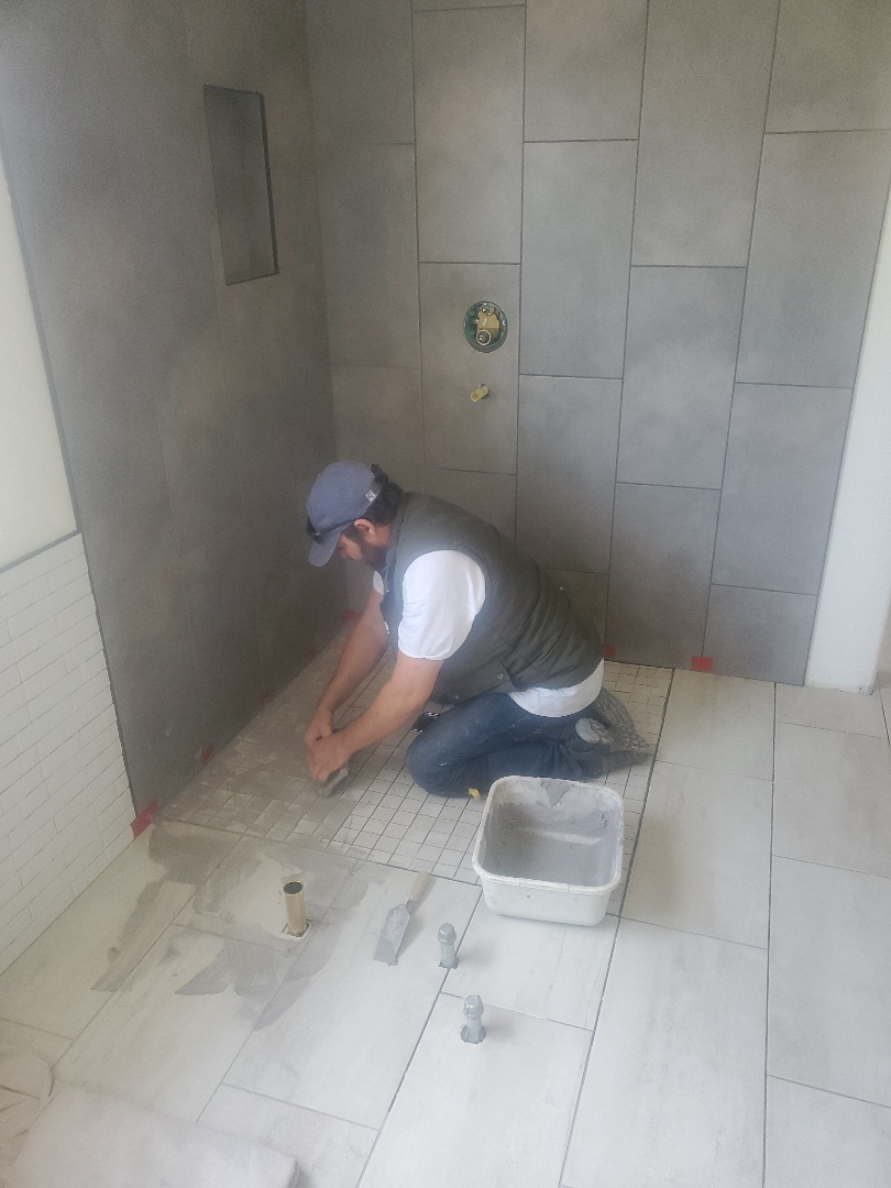 Brentwood, CA - Today we started the grouting process around the downhill slide on the whole project