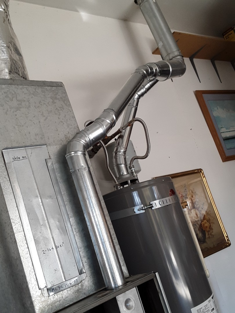 Everett, WA - Replaced exhauste flue vent for a Rheem gas furnace in Everett