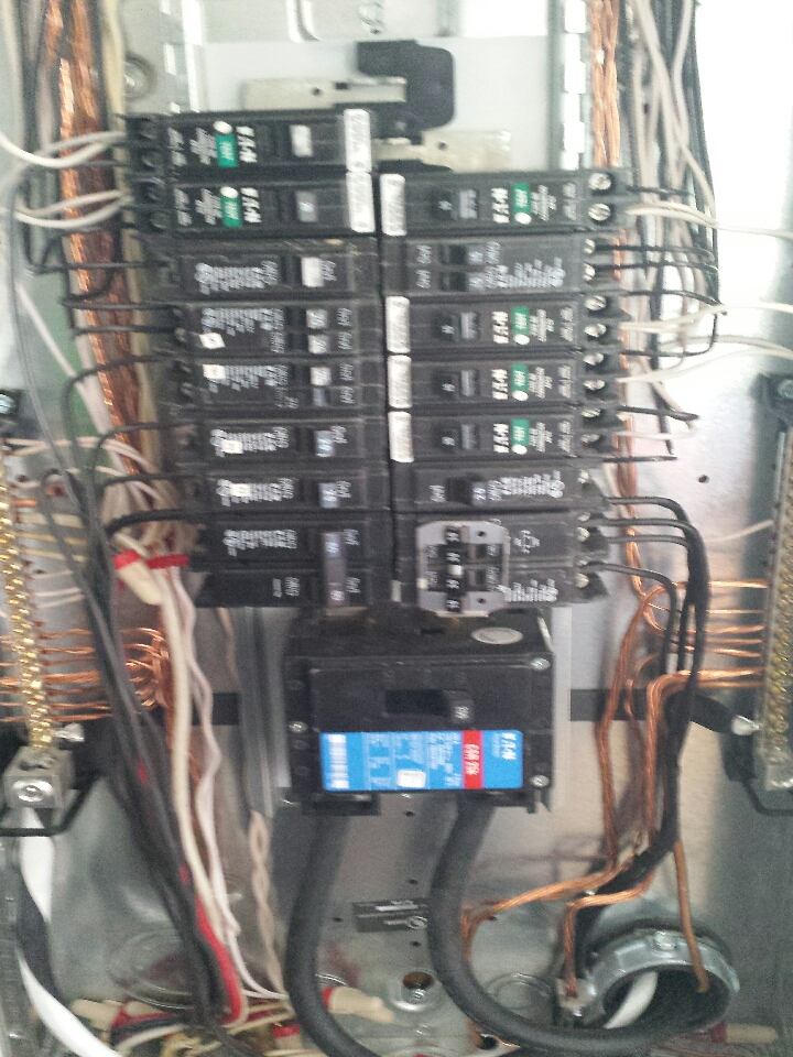 Monroe, WA - electrician. installing new 15 amp and 20 amp arc fault breaker in cutler hammer panel