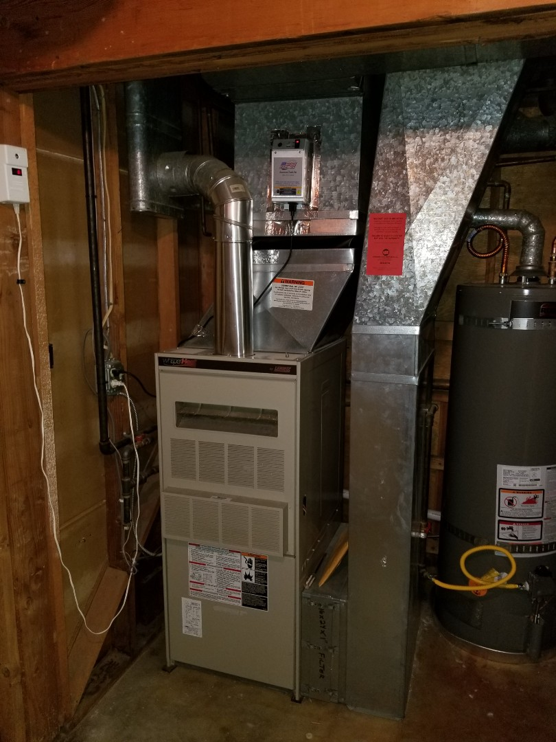 Lynnwood, WA - Providing an estimate to install a Lennox Elite Series EL16 air conditioner in Stanwood.