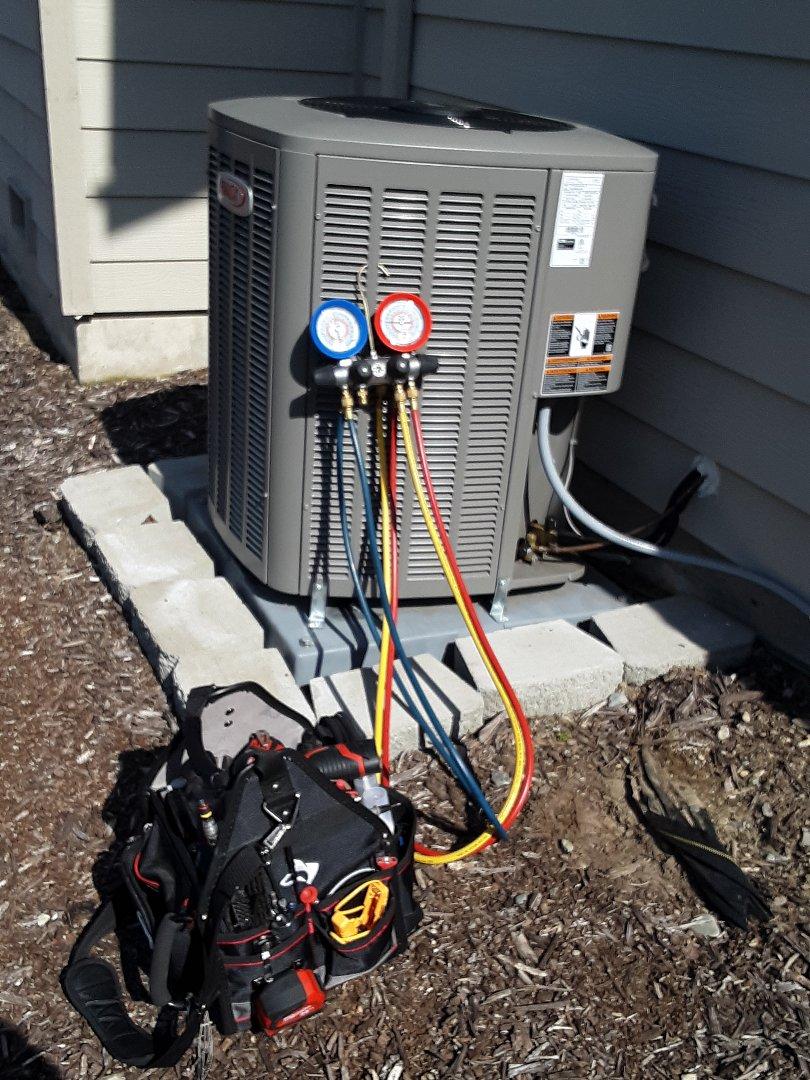 Mill Creek, WA - Air conditioning maintenance on a Lennox heat pump