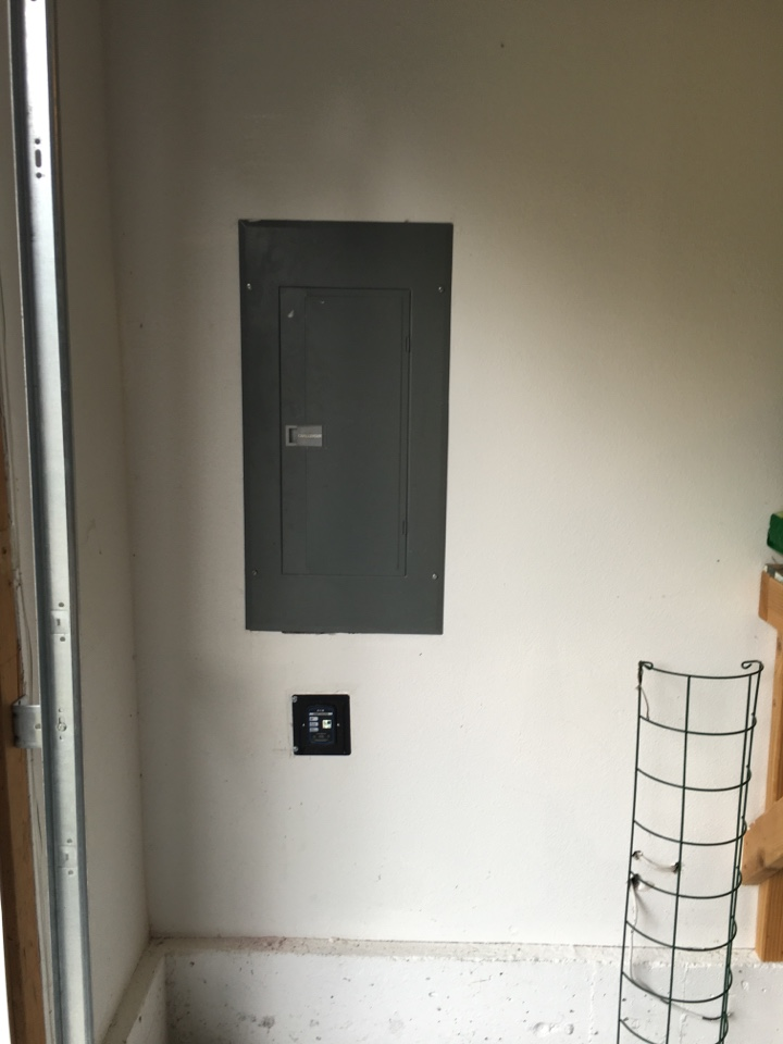 Bellevue, WA - Electrician. Electrical installation of a whole house surge protector. Redmond